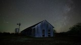 Night time lapse of stars above on old rustic barn - 231021458