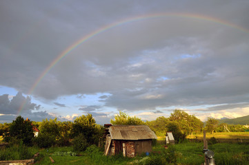 A beautiful full rainbow in the old village