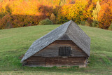 A Beautiful Wooden Cottage Standing in the Shadow at Sunset - 231069633