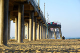 Beach and pier in morning with surfers - 231081216