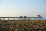 Beach with pier and people in morning - 231082251