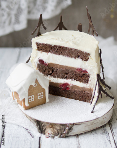 Leinwandbild Motiv Black forest cake, Schwarzwald pie, dark chocolate and cherry dessert on wooden background. New Year or Christmas cake, decorated with chocolate fir and cookie house. Copy space, selective focus