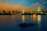 Colorful illuminations at Rainbow Bridge from Odaiba in Tokyo, Japan