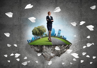 Confident lady boss and modern city as concept of eco green construction