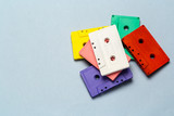 Bright retro cassette tapes on a light grey background - 231136420