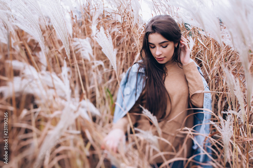 Portrait of a girl in high grass.