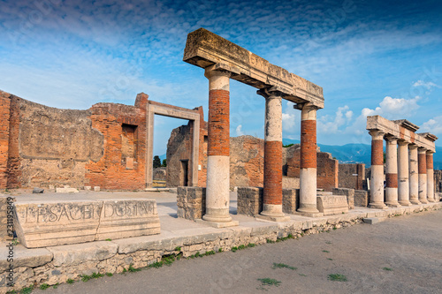 Stone and brick columns in The Forum in the archaeological excavations of Roman Pompeii near Naples, Campania, Italy. - 231195849