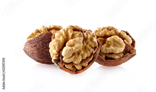 Walnuts in closeup on white background - 231197293