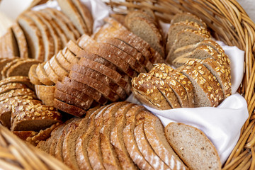Fresh baked bread with seeds in a basket
