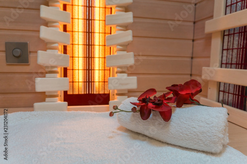 Leinwanddruck Bild Infrared cabin interior with a white towel and a wonderful flower