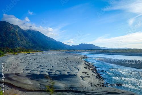 Leinwandbild Motiv River in New Zealand mountains