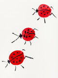 three ladybugs drawn by red and black watercolors