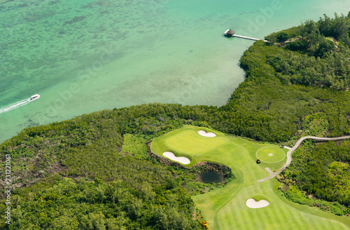 Foto Murales Aerial picture of golf course of l'île aux cerfs in Mauritius island