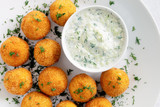 lentil croquettes with cacik sauce decorated with dill - 231229043