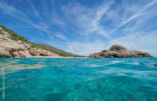 Spain Costa Dorada, the beach and the islet of Torn seen from the water surface, l'Hospitalet de l'Infant, Mediterranean sea, Tarragona, Catalonia