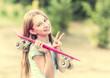 Teenage girl with pink skateboard smiling