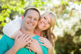 Young Attractive Couple Hugging in the Park - 231234879