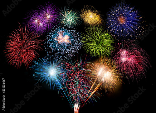 colorful fireworks display and bright sparkler pyrotechnic happy new year background