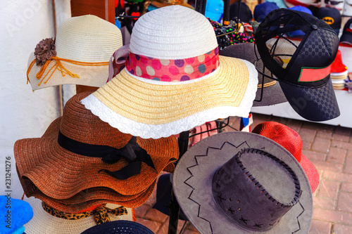 Men s and women s hats in retro vintage style on sale in the market ... 65edd5ef462