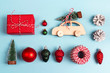 Leinwanddruck Bild - Set of Christmas decorations on blue background. Wooden toy car with Christmas tree on the roof, gift box and other baubles.