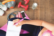 Top view healthy woman planning daily workout at home, Diet and fitness concept