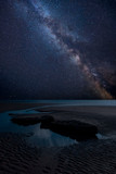 Vibrant Milky Way composite image over landscape of Dunraven Bay in Wales - 231288627