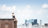 Businesswoman or accountant on brick roof against modern city scape - 231289485