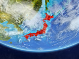 Japan on realistic model of planet Earth with country borders and very detailed planet surface and clouds.