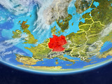 Germany on realistic model of planet Earth with country borders and very detailed planet surface and clouds. - 231299657