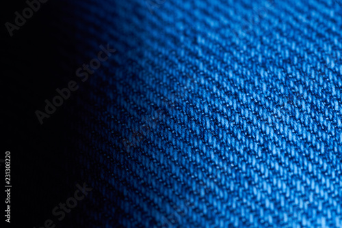 macro photo of blue jeans fabric, color gradient from black to blue. - 231308220