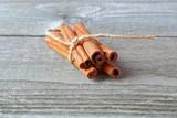 Cinnamon sticks on wooden background - 231326248