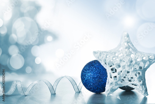 Christmas Holiday Background decorated with baubles, light garland. Christmas and New Year Decoration © Catwoman