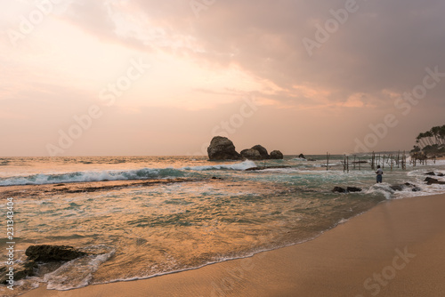 sunset on the coast of the Indian Ocean - 231343404
