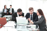 employees of the company discussing with the client the terms of the contract - 231356221