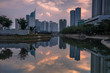 Magnificent of Jakarta cityscape. Office buildings reflected on the water with cloudy sky in the dusk, Jakarta, Indonesia.