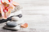 Spa still life with pebbles and red orange orchid - 231369241