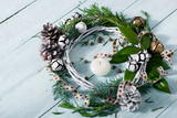 Christmas wreath on bright wood table background - 231369458