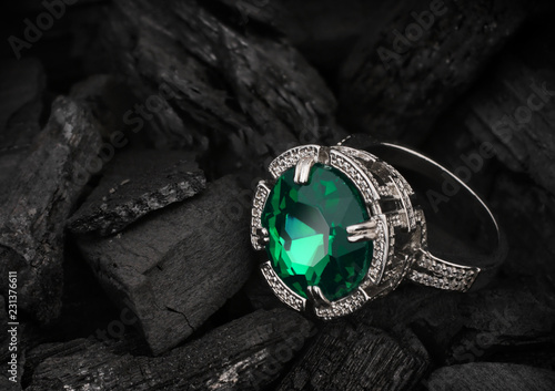 jewelry ring with big tourmaline gem on black coal background - 231376611