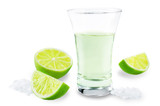 Glass of tequila liquor with salt and lime fruits isolated