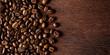 fresh roasted coffee beans on natural dark oak wood panorama wide wooden closeup macro background