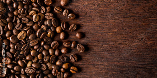 fresh roasted coffee beans on natural dark oak wood panorama wide wooden closeup macro background - 231394892