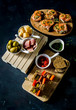 Appetizers for aperitif with canapes, olives, cheese, ham and toast - 231405019