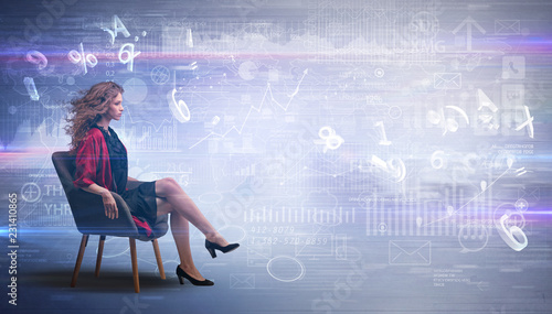 Leinwandbild Motiv Elegant woman sitting in a sofa with numbers and reports concept
