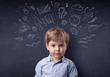 Leinwanddruck Bild - Smart little kid in front of a drawn up blackboard ruminate