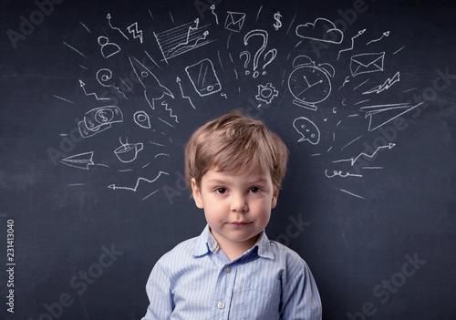 Leinwanddruck Bild Smart little kid in front of a drawn up blackboard ruminate