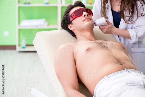 Leinwandbild Motiv Young man visiting doctor for epilation