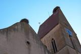 Eguisheim,France-October 13, 2018: Stork nest on Parish Church or St. Peter and St. Paul church in Eguisheim