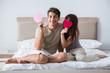 Leinwanddruck Bild - Happy couple in the bed