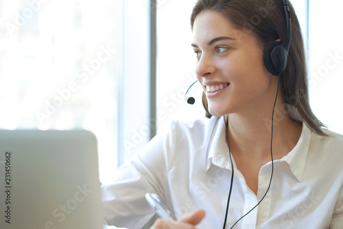 Leinwandbild Motiv Customer support operator working in a call center office.