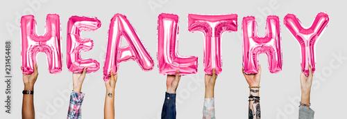 Leinwanddruck Bild Hands showing healthy balloons word